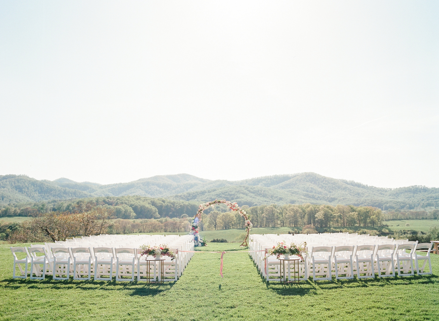 Wedding ceremony set up with flower arch
